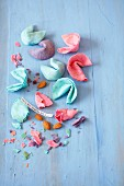 Colourful, homemade fortune cookies, partially crumbled