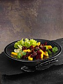 A beetroot and mango salad with a lemon and ginger dressing