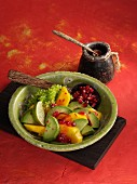 Mango and avocado salad with spicy pomegranate seed dressing