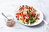 Prawn salad with grapefruit, cucumber and pomegranate seeds
