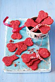 Treats for a dog - bone shape biscuits made with beetroot juice, oats and wholemeal flour