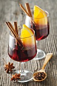 Mulled wine with spices and orange wedges