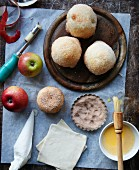 Pastry-wrapped apples with cinnamon sugar and ingredients