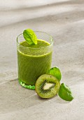 Spinach and kiwi smoothie with almond milk, chia seeds and wheat grass powder