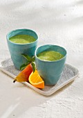 Kale smoothies with banana, pears, orange juice and almond milk