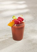 A raspberry and kale smoothie with mango and ginger