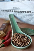 Chinese coriander seeds on a spoon