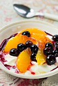 Blueberries and oranges with yoghurt