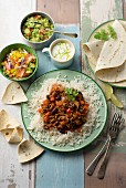 Chilli con carne with rice, salsa, guacamole and sour cream