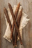 Black salsify on a beige cloth