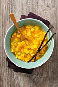 Iced mango soup with lime zest and vanilla pods
