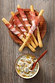 Grissini with Parma ham and a pine nut dip