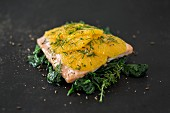 Oven-baked salmon fillet with orange slices, spinach and dill (low carb)