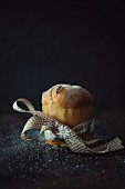 A mini panettone tied with a ribbon
