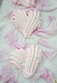 Raspberry meringue hearts with sugar pearls