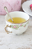 Spring herb tea in an antique mug