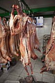 Lamb carcasses hanging in a butcher's