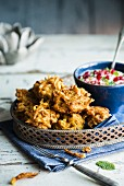 Onion bhajis (deep fried onions in batter, India) with raita