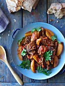 Hungarian goulash with vegetables and coriander