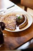 Pork sausage with liver dumplings and potato cake, Lake Geneva, Switzerland