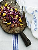 Winter red cabbage salad with grapes, oranges and nuts