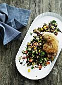 Chicken leg on a rice salad