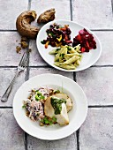 Chicken with pesto and various side salads