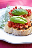 Bruschette (grilled bread topped with tomato and basil, Italy)