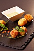 Fish balls with a yoghurt and pesto sauce