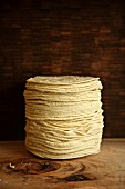 A stack of tortillas on a wooden table