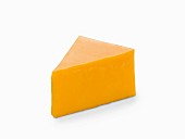 A slice of cheddar cheese on a white surface