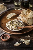 Bread crisps with a tuna fish dip