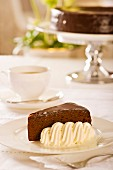 Sachertorte (rich Austrian chocolate cake) with whipped cream