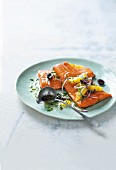 Oven-baked salmon trout with olive and orange salsa