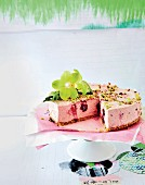 Cherry cheesecake with pistachio nuts and sesame seeds