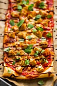 Puff pastry pizza topped with barbecue chicken