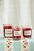 Jars of homemade strawberry jam on a table