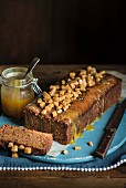 Sticky toffee pudding with caramel sauce and toffee chunks (England)