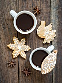 Two cups of coffee served with homemade gingerbread biscuits