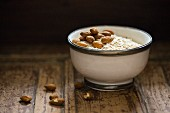 A bowl of oats with almonds (ingredients for making porridge)