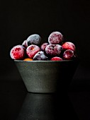 A bowl of frozen cherries