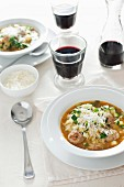 Mediterranean soup with orzo pasta, meatballs and courgettes