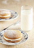 Pumpkin whoopie pies served with a glass of milk