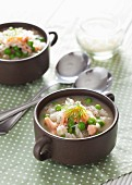 Soup with risotto rice, salmon and peas