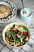 Fresh spinach salad with dried tomatoes and Tigella breadsticks