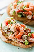 Prawn toasts with tomatoes