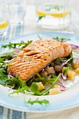 Salmon with mango and onion salsa