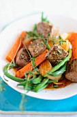 Lamb with beans and carrots