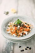 Carrot and apple salad with feta cheese and pumpkin seed pesto