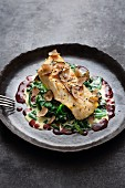 Fried turbot with truffles, spinach and a red wine and butter sauce